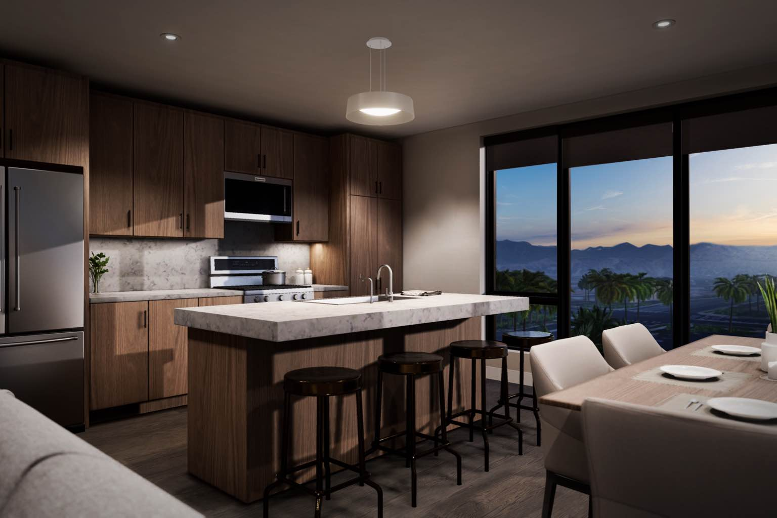 High-end kitchen in an apartment with a sunset mountain view out the window